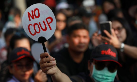 Hundreds Gather at Bangkok's Democracy Monument to Demand Election