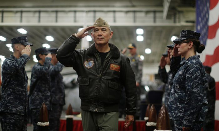 U.S. Navy Adm. Harry Harris, Commander of the U.S. Pacific Command, salutes at a ceremony marking the start of Talisman Saber 2017, a biennial joint military exercise between the United States and Australia, aboard USS Bonhomme Richard on June 29, 2017. President Donald Trump has announced the intention to nominate Harris to be the next U.S. ambassador to Australia. (Jason Reed/AFP/Getty Images)