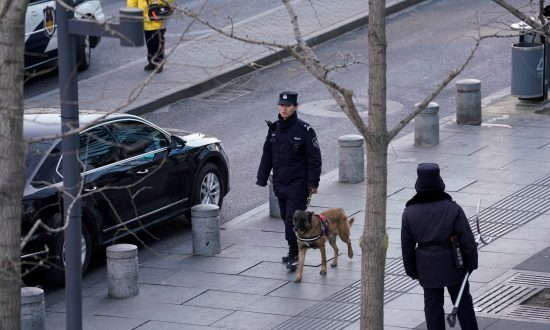 Police patrol outside the Joy City Mall in the Xidan district after a knife attack, in Beijing, China, on Feb. 11, 2018. (Reuters/Jason Lee)