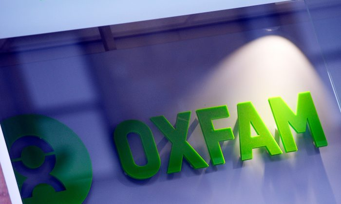 The logo on the front of an Oxfam bookshop is photographed in Glasgow on Feb. 10, 2018.  The British Government announced late on Feb.9 it was reviewing all work with Oxfam amid revelations the charity's staff hired prostitutes in Haiti during a 2011 relief effort on the earthquake-hit island. (ANDY BUCHANAN/AFP/Getty Images)