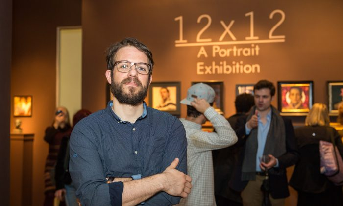 """Stephen Bauman, artist and curator of """"12x12, A Portrait Exhibition,"""" at the opening in the gallery of The Florence Academy of Art, at Mana Contemporary in Jersey City, N.J., on Jan. 12, 2018. (Benjamin Chasteen/The Epoch Times)"""