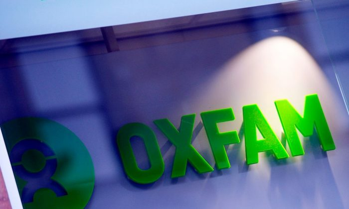 The logo on the front of an Oxfam bookshop is photographed in Glasgow on February 10, 2018.  The British Government announced late on February 9 it was reviewing all work with Oxfam amid revelations the charity's staff hired prostitutes in Haiti during a 2011 relief effort on the earthquake-hit island. (Andy Bechanan /AFP/Getty Images)