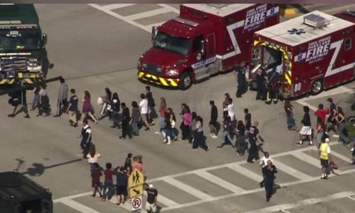 Students are evacuated from Marjory Stoneman Douglas High School during a shooting incident in Parkland, Florida, U.S. February 14, 2018 in a still image from video. (WSVN.com via REUTERS)