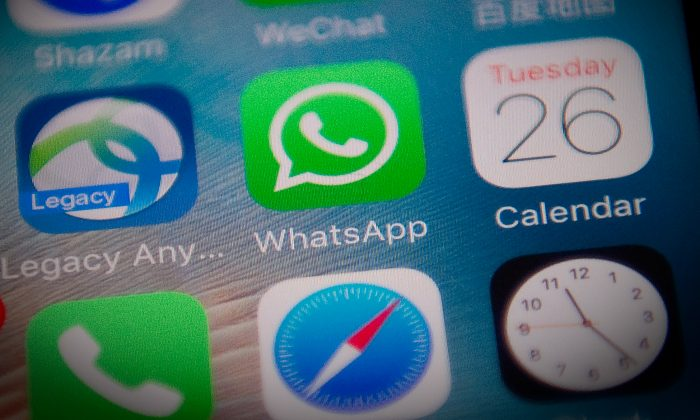 This photo illustration shows the Whatsapp application logo (C) on a smartphone screen in Beijing on September 26, 2017. (Nicolas Asfouri/AFP/Getty Images)