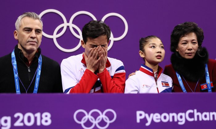 Tae Ok Ryom and Ju Sik Kim of North Korea react after competing during the Pair Skating Free Skating at Gangneung Ice Arena in Gangneung, South Korea, on Feb. 15, 2018. (Jamie Squire/Getty Images)