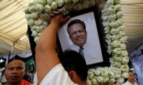 Widow and Sons of Murdered Cambodian Government Critic Arrive in Australia As Refugees