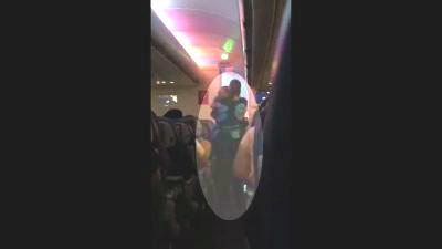 Flight Attendant Calms Down Toddler on Late-Night Flight