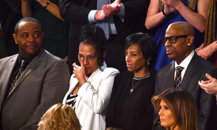 (L-R) Robert Mickens, Elizabeth Alvarado, Evelyn Rodriguez, and Freddy Cuevas are recognized during the State of the Union address at the US Capitol in Washington, DC, on January 30, 2018. / AFP PHOTO / Nicholas Kamm        (Photo credit should read NICHOLAS KAMM/AFP/Getty Images)