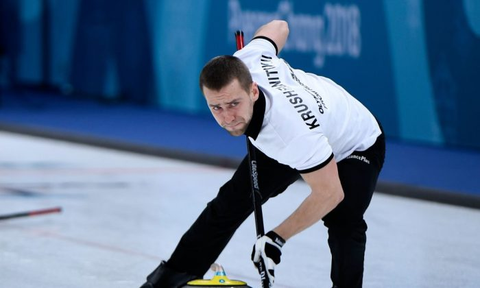 Russia's Aleksandr Krushelnitckii in the olympic curling mixed doubles in Pyeongchang  on February 8, 2018. (Wang Zhao/AFP/Getty Images)