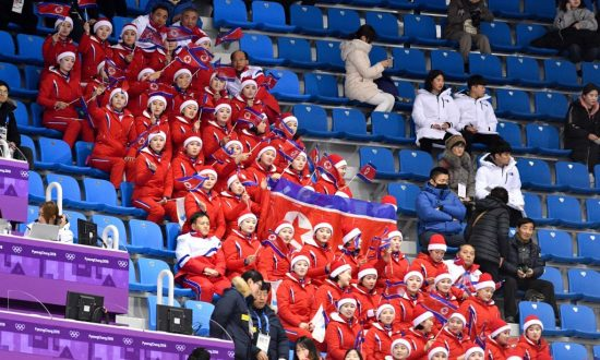 North Korean Olympic Cheerleader Caught Cheering for Americans