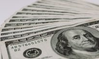 Volunteer Finds $4,000 in Old Book, Tracks Down Owner to Return Money