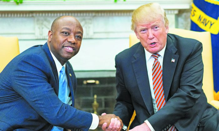 Sen. Tim Scott (R-S.C.) and President Donald Trump shake hands during a working session regarding Opportunity Zones following the recently signed tax bill at the White House on Feb. 14. (MANDEL NGAN/AFP/GETTY IMAGES KCNA VIA)