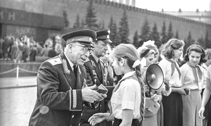 Children are given their Komsomol memberships in Moscow's Red Square on May 19, 1968. The Soviet Union allegedly used the Komsomol camps to experiment on pedophilia. (RIA NOVOSTI ARCHIVE)