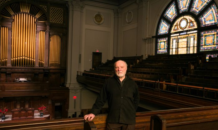 """The director of Early Music New York, Frederick Renz prepares ahead of the March 3 concert """"Haydn in Esterházy: Genial Kapellmeister"""" at the First Church of Christ, Scientist, in New York on Feb. 19, 2018. (Benjamin Chasteen/The Epoch Times)"""