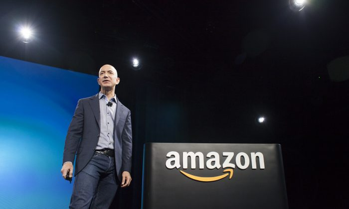 FILE—Amazon.com founder and CEO Jeff Bezos at a presentation in Seattle, Washington on June 18, 2014. (Photo by David Ryder/Getty Images)