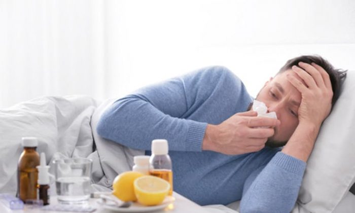 Influenza gets a foothold in the respiratory tract but can make a person feel bad all over. (Africa Studio/Shutterstock.com)