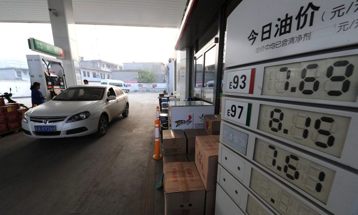 A car fills up at a petrol station in Hefei City, in east China's Anhui Province on May 10, 2012. (STR/AFP/GettyImages)