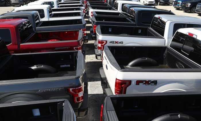 Ford F-150 pickup trucks at a dealership Oct. 26, 2017 in Miami. The F-150 has been the best selling vehicle in the United States for over a decade. (Photo by Joe Raedle/Getty Images)