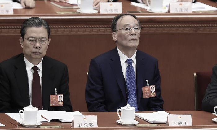 Wang Qishan (R), former head of the Chinese Communist Party's anti-corruption agency, attends the opening session of the National People's Congress, China's rubber-stamp legislature, in Beijing's Great Hall of the People on March 5, 2018. (Wang Zhao/AFP/Getty Images)