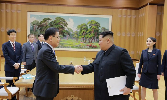 North Korean leader Kim Jong Un shakes hands with a member of the special delegation of South Korea's President in this photo released by North Korea's Korean Central News Agency (KCNA) on March 6, 2018. (KCNA/via Reuters)