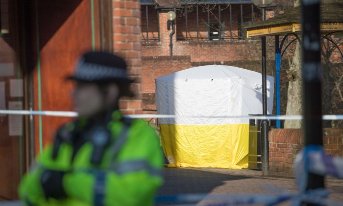 police tent is seen behind a cordon outside the shopping centre in in Wiltshire, England where a man and a woman were found critically ill on a bench on March 4 and taken to hospital sparking a major incident, on March 7, 2018. (Matt Cardy/Getty Images)