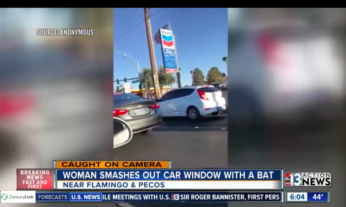 A woman hits an SUV with a bat in Las Vegas in a fit of road rage on March 2, 2018. (Screenshot via Youtube/