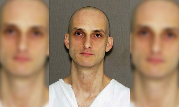 Inmate Brian Jordan, 33, escaped from a hotel room where his guard fell asleep. (East St. Louis Police)