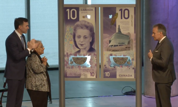 (L to R) Finance Minister Bill Morneau, Wanda Robson, and Bank of Canada Governor Stephen Poloz at the unveiling of the new $10 note in Halifax, Nova Scotia, on March 8, 2018. (Bank of Canada / screenshot)