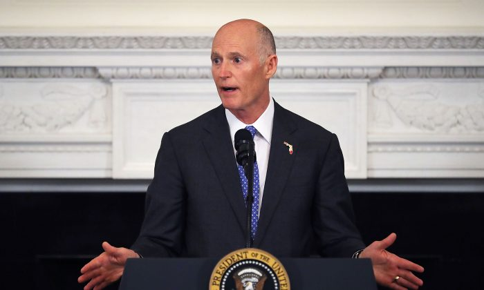 """Florida Governor Rick Scott will have the """"Sunshine Protection Act,"""" on his desk soon. Here the Governor speaks at the White House, Feb. 26, 2018. (Chip Somodevilla/Getty Images)"""
