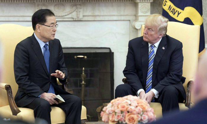 South Korea's national security chief Chung Eui-yong briefs U.S. President Donald Trump at the Oval Office about his visit to North Korea, in Washington March 8, 2018. (The Presidential Blue House/Yonhap via Reuters)