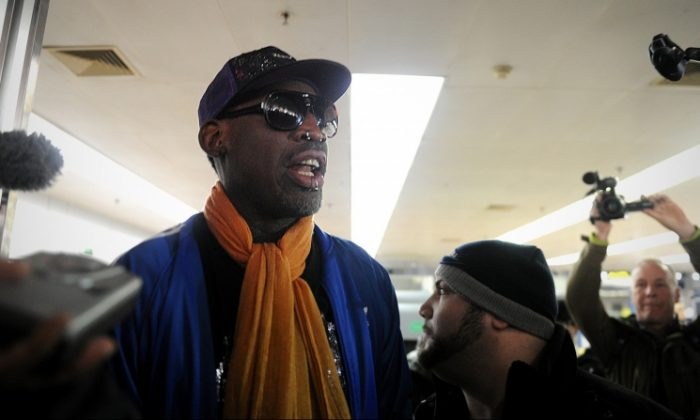 Former US basketball player Dennis Rodman (C) talks to the media upon arriving at Beijing International Airport from North Korea on January 13, 2014. (WANG ZHAO/AFP/Getty Images)