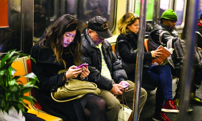 Commuters on the subway in New York in this file photo. (SAMIRA BOUAOU/THE EPOCH TIMES)