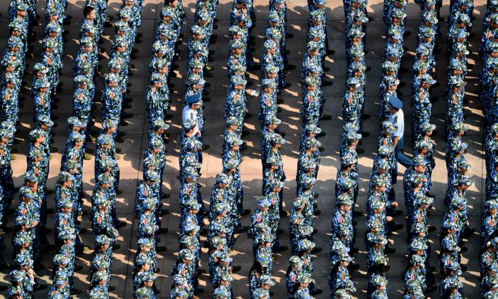 About 7,000 freshmen wearing fatigues gather at the Wuhan University of Technology during a military training in Wuhan City, Hubei Province on Sept. 14, 2015.  (VCG via Getty Images)