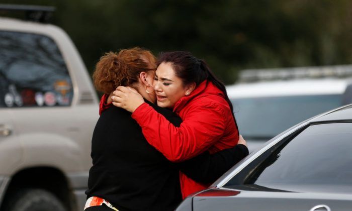 Vanessa Flores (R) embraces another woman after she leaves the locked down Veterans Home of California during an active shooter turned hostage situation on March 9, 2018 in Yountville, California.(Stephen Lam/Getty Images)