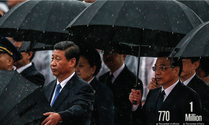 Chinese leader Xi Jinping (front, L), Premier Li Keqiang (front, R), and other Chinese Communist Party top officials stand in the rain during a ceremony marking the 64th anniversary of the Party's takeover of China, at Tiananmen Square in Beijing on Oct. 1, 2013. (FENG LI/GETTY IMAGES)