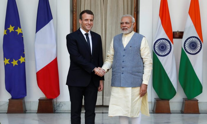 French President Emmanuel Macron shakes hands with India's Prime Minister Narendra Modi during a photo opportunity ahead of their meeting at Hyderabad House in New Delhi, India, March 10, 2018. (Reuters/Cathal McNaughton)