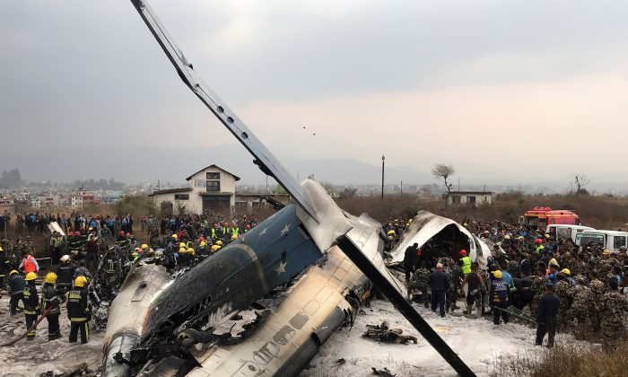 Wreckage of an airplane is pictured as rescue workers operate at Kathmandu airport, Nepal, March 12, 2018. (Reuters/Navesh Chitrakar)