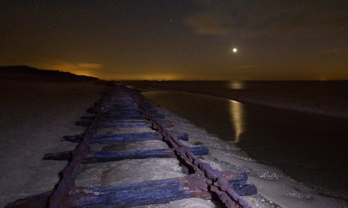 Century-old railroad tracks  show up on a beach in  New Jersey in 2014. (Werner Tedesco)