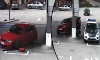 Security Cam Captures Lucky Escape as Car Plows Into Petrol Station