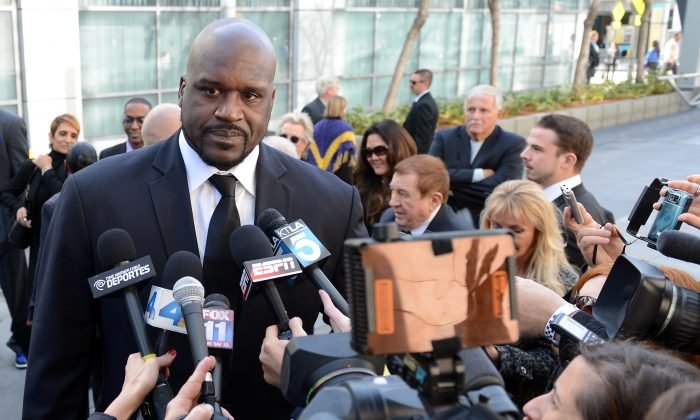 Former Los Angeles Lakers star Shaquille O'Neal addresses the media before a memorial service for Los Angeles Lakers owner Dr. Jerry Buss at the Nokia Theatre in Los Angeles on Feb. 21, 2013. (Photo by Harry How/Getty Images)