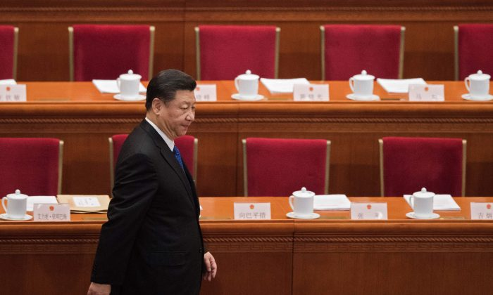 Chinese leader Xi Jinping arrives for the fourth plenary session of the National People's Congress (NPC) at the Great Hall of the People in Beijing on March 13, 2018. (Nicolas Asfouri/AFP/Getty Images)