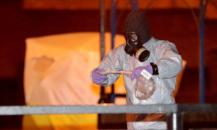Police officers in forensics suits and protective masks work at the scene of the poisoning of Sergei Skripal on March 13, 2018 in Salisbury, England. (Christopher Furlong/Getty Images)