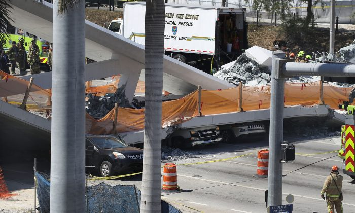 Vehicles are seen trapped under the collapsed pedestrian bridge in Miami, Fla., on March 15, 2018.  (Joe Raedle/Getty Images)