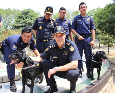 Directorate General of Customs and Excise (DGCE) detector dog handler, Director General of DGCE Mr Heru Pambudi and ABF Commissioner Roman Quaedvlieg with gifted dogs on Aug. 24, 2015. (Commonwealth of Australia)