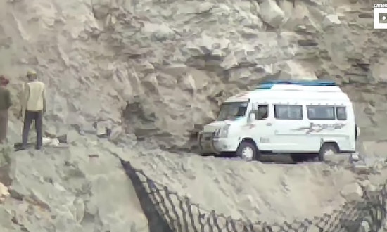 Driver is making it's way along a cliff, but when camera zooms out—you see exactly where he is