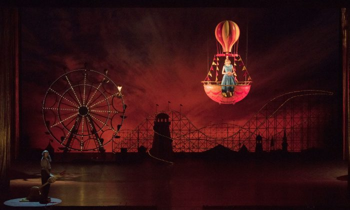 "A scene from Act II of Wolfgang Amadeus Mozart's ""Così fan tutte,"" set at Coney Island in the 1950s.  (Jonathan Tichler/The Metropolitan Opera)"