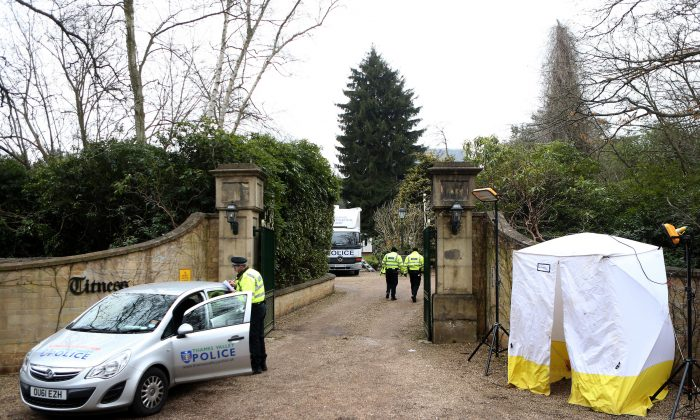 A police car and a police tent are positioned outside the gates of the house of Russian tycoon Boris Berezovsky in Sunningdale near Ascot in Berkshire, southwest of London, on March 25, 2013. (Ben Stansall/AFP/Getty Images)