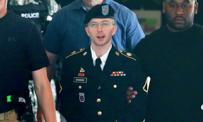 U.S. Army Private First Class Bradley/Chelsea Manning is escorted by military police as he leaves his military trial after he was found guilty of 20 out of 21 charges on July 30, 2013, in Fort George G. Meade, Maryland. (Mark Wilson/Getty Images)