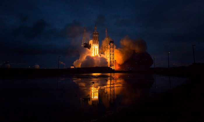 The Delta IV Heavy rocket with NASA's Orion spacecraft mounted atop, lifts off from Cape Canaveral Air Force Station's Space Launch Complex 37 at 7:05 a.m. on Dec. 5, 2014, in Cape Canaveral, Fla. (Bill Ingalls/NASA via Getty Images)