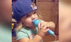 Two year old steps up on a stool & starts singing National Anthem—you have to hear this